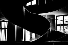 Downward spiral (I am still alive) Tags: spiral staircase london black white shot canon camer adobe lightroom photo shop monochrome whire light dark grain windows window shadow ollie oliver parsons photographer winding noise sloping downwards tradition classic old england uk gb