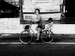 ((Jt)) Tags: iphone se iphonese shotoniphonese shotoniphone blackandwhite monochrome jtinseoul iksan southkorea mobilephotography iphoneography streetphotography travelphotography koreanwomen bicycle portrait