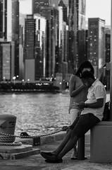 Modern Love Affair (mark-marshall) Tags: nikon nikkor nikond500 f28 afsnikkor70200mmf28gedvrii bw monochrome chicago lakemichigan navypier lovers phone phonezombies cityscape hmbt