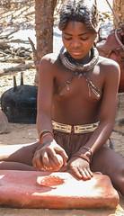 making ochre paste to rub on the skin (alunwilliams155) Tags: ochre himba namibia