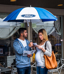 ORDERING OUT   P9020139.jpg (Marc Weinberg) Tags: streetscenes streetshooter menu couple pregnant woman restaurant sidewalkcafe rain umbrella ford