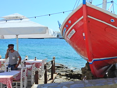 Waiting for the ouzo supplies (Couldn't Call It Unexpected) Tags: boat hull greek sailor cyclades aegean cigarette restaurant greece