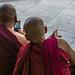Texting monks. Yangon, Myanmar