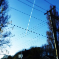 Inbound flight. (Bhlubarber) Tags: city urban vancouver plane square wire flight squareformat tinto 1884 iphoneography instagramapp uploaded:by=instagram