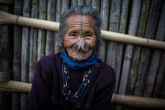portrait of an old woman Apatani, ziro, arunachal pradesh (anthony pappone photography) Tags: old travel portrait india tattoo canon hair spirit piercing bamboo oldwoman tribe ethnic ritratto bambu arunachal etnic arunachalpradesh animist ziro apatani animisti apatanitribe donyipolo plateinnose