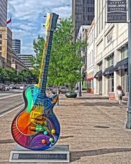 Vibrancy (DASEye) Tags: travel sculpture music austin texas guitar streetscene olympus gibsonguitar vibrancy dayseye davidadamson creativephotocafe