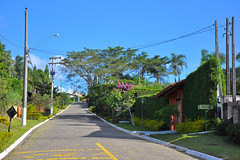 Quiet Street Interior Brazil ([visual media]) Tags: street blue houses brazil sky house building home southamerica electric horizontal brasil countryside quiet saopaulo interior country wires blocks poles paulo asphalt sao curb chacara countryhouse entrances pepples