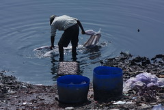 man and pollution at hajaribag area on the bank of dying river buriganga (bimboo.babul) Tags: poverty winter people woman fog children lifestyle health drought ash environment dailylife climatechange slum poisonous profession tannery dwelling polution buriganga transpor workingpeople tennery dyingriver chemicalpollution riskyprofession manmadepollution landribber