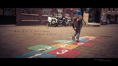 One Day in Amsterdam - Number Se7en (Jeff Krol) Tags: street trip blue boy urban holland art netherlands dutch amsterdam playground 35mm kid walk f14 capital nederland streetphotography sigma oneday numbers seven series se7en canon5d hopscotch cinematic serie straat hinkelen capitalcity citytrip straatfotografie 2013 1dag jeudemarelle sigma35mmf14 5dmarkii artlens 5dmkii 5dmk2 jeffkrol sigma35mmf14dghsma onedayinamsterdam 1daginamsterdam 20130413000img1383