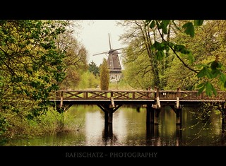 water, wooden bridge and windmill