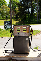 Gas Pump (Samantha Evans of TSI Photography) Tags: road blue red white black building tree green glass grass sign metal canon handle words weeds rust decay urbandecay letters gray cement structure hose pump numbers powerline asphalt powerpole curb unleaded nozzle menlo 145 143 canon60d powerplus menloga abandondedgasstation