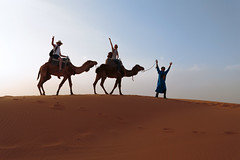 On camels, in the Sahara! (Sebastian Anthony) Tags: blue sahara yellow sand desert morocco berber camels