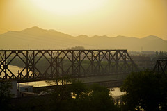 (memos to the future) Tags: china city travel bridge train river landscape rail railway goldenhour lateafternoon earlyevening ktrain chinarailways