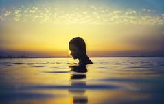Carolina (Daniel Galan Lorente) Tags: yellow sunset sun girl water beach spain model contrast contraluz pentax colours colors