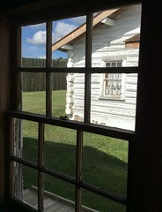 View of white-washed log cabin through a window (peggyhr) Tags: peggyhr level1photographyforrecreation level2photographyforrecreationsilveraward musictomyeyes~l1