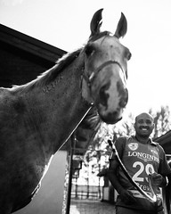 Now you can tell that horses have a positive influence. That's why horse lovers are passionate and happy people. Enjoy this smile . It is coming from the heart. (Netpad) Tags: social documentary people equine equestrian friendly championship outdoor blackandwhite bw sport race work animal portrait face smile horse