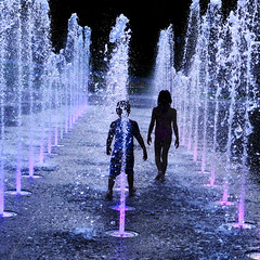 A Warm Evening, Kids and Water. (Steve Corey) Tags: waterfountain kids children play blackandwhite quebec silhouettes fun childrenplay