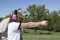 Kristen Monroe at the range (Dan Small Outdoors) Tags: pistol handgun branson aglow mattrice concealedcarry dansmall outdoorsradio kristenmonroe blueheroncommunications associatioonofgreatlakesoutdoorwriters