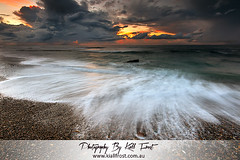 Burwood Beach (Kiall Frost) Tags: ocean red white storm colour beach water rain clouds sunrise flow photo nikon image dramatic pebbles lee flowing filters drama burwood merewether 1635mmf4 kiallfrost d800e