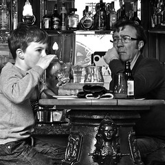 1 beer & 1 chocolate milk (Akbar Simonse) Tags: street boy people bw holland blancoynegro beer monochrome amsterdam bar square kid cafe pub dad child bottles zwartwit candid father nederland safari bier chocolatemilk baileys duvel cointreau straat flessen amaretto chocomel pisangambon urrban dedoka akbarsimonse chcolademelk