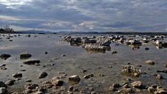 In the Light on the Stones. (mcginley2012) Tags: ireland sky sunlight lake reflections landscape rocks day cloudy stones limestone loughcorrib