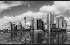 Lower Manhattan Skyline (wowography.com) Tags: nyc longexposure sky bw ny newyork skyline architecture clouds photoshop buildings reflections river landscape bay harbor nikon manhattan nypd nik hudson wallstreet lowermanhattan statenislandferry lightroom yahoonews southferry d90 freedomtower wowography dfine2 silverefexpro 211405 wowographycom