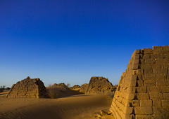 Pyramids And Tombs In Royal Cemetery Of Bajrawiya, Meroe, Sudan (Eric Lafforgue) Tags: africa travel sky brown history tourism archaeology nature cemetery horizontal architecture outdoors photography death sand memorial day desert pyramid northafrica soedan sudan tomb tranquility sunny bluesky nobody nopeople unescoworldheritagesite copyspace custom sanddune ancientcivilization khartoum nubia royalty thepast scenics ruined soudan tranquilscene saharadesert northernafrica meroe traveldestinations colorimage naturalpattern beautyinnature buildingexterior fulllenght oldruin merowe aridclimate  szudn sudo  builtstructure northernsudan pyramidsofmeroe northsudan blackpharaohs      xuan eri8050