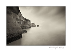 Haunted Whispers (Maxwell Campbell) Tags: ocean longexposure sea newzealand bw cliff mist seascape beach clouds sunrise canon landscape photography coast waterfall rocks tunnel coastal nz southisland otago dunedin kiwi kiaora silvereffex maxwellcampbell