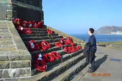 Paying respects (Silcoxski) Tags: uk wales memorial europe britain aberystwyth poppies remembrance warmemorial ceredigion aber