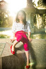 On a fountain (Beezer One) Tags: pink red sun fountain girl glitter evening belt spring nikon shoes glow polka flare dots hmong hmoob d600 singhrayvarind