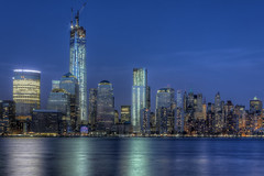 One World Trade Center Construction - Blue Hour (1982Chris911 (Thank you 1.250.000 Times)) Tags: newyorkcity blue newyork america canon newjersey jerseycity path manhattan worldtradecenter nj wintergarden manhattanskyline bluehour atrium groundzero batteryparkcity worldfinancialcenter lowermanhattan merrilllynch americanexpress goldmansachs manhattannewyork newyorkcityphotography newyorkskyscraper canon5dmkii oneworldtradecenter canoneos5dmarkiii eos5dmarkiii canoneos5dmark3 goldmansachsheadquarter merrilllynchworldhq eos5dmark3