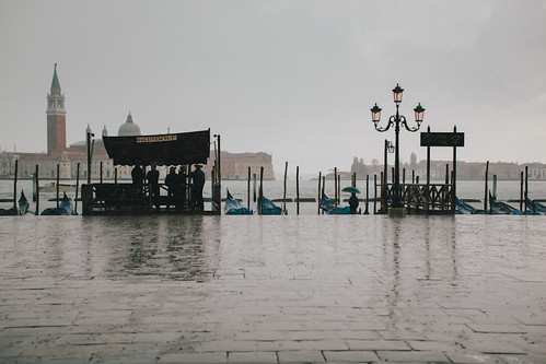 Gondoliers During The Rain