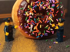 Minifigure Police Take on the Donut. (catherine4077) Tags: donut sprinkles chocolate legos legosminis minifigures police logopolice