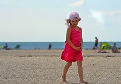 The Girl in the Pink Dress (Clare-White) Tags: pink beach shy girl female sand stones blue hat dress ijmuiden sky candid pov faded