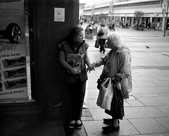 Big Issue Seller - Sunderland (Richard James Palmer) Tags: mamiya7ii mamiya 7ii 80mm ilford hp5 ilfordmicrophen microphen ishootfilm shoot film iso 400 iso400 ilfordhp5 f4 northeast north east street photography streetphotography portrait black white rangefinder medium format 120 filmisnotdead analogue documentary epsonperfectionv700 epson v700 1125 newcastleupontyne upon tyne tyneandwear northern uk england urban melancholy art fineart new overcast isolated walkabout 2016 gritty gloomy abstract trapped blackandwhite monochrome sunderland