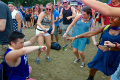 feeling it (KevinIrvineChi) Tags: blue wayfarers glitter body paint fanny packs grass lawn dance dancing dancers circle smile smiling smiles happy arms bent dress joey purp lollapalooza illinois outdoors outside festival music concert show braids blonde wristband cubs attention sony dscrx100