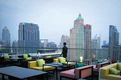 Krung Thep, the city of angels (fredcan) Tags: asia southeastasia thailand bangkok krungthep city cityofangels capital siam rooftop bar terrace buildings towers skyscrapers skyline evening urbanenvironment man standing barman travel fredcan centralworld siamsquare