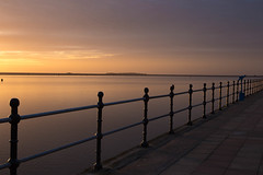 Golden Slumbers (cathbooton) Tags: telescope shadows promenade canon6d canoneos canonusers hilbreisland lake water lowlight merseyside wirral westkirby sunset litup light railings