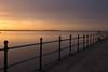 Golden Slumbers (cathbooton) Tags: telescope shadows promenade canon6d canoneos canonusers hilbreisland lake water lowlight merseyside wirral westkirby sunset litup light railings