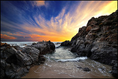 ...walking through the rocks... (zio.paperino) Tags: sunset sea sky italy panorama orange beach nature water yellow clouds landscape atardecer mar sand nikon rocks europa europe italia tramonto nuvole mare waves coucher playa natura ciel cielo sole puesta plage calabria tropea d800 susnset 14mm samyang frameit mygearandme mygearandmepremium photographyforrecreation d800e