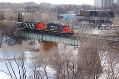 Photo taken at the Forks in Downtown Winnipeg (Jeannette Greaves) Tags: bridge cn train track winnipeg rail historic manitoba forks 2013