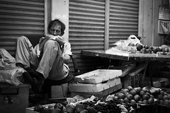 mement in the afternoon () Tags: life street door leica people blackandwhite bw man apple monochrome true shop fruit 50mm mono stand newspaper asia image taiwan streetphotography lifestyle snap read summicron kaohsiung   society vender  mement  m9p