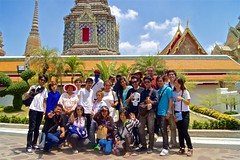 Group portrait at Wat Pho, home of the Reclining Buddha, Bangkok, Thailand (UweBKK ( 77 on )) Tags: portrait people thailand religious temple worship asia bangkok buddha buddhist sony religion social sacred reclining southeast alpha dslr wat pho watpho 550 recliningbuddha 9templestour