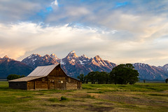 Barn and Tetons Early Morning (grimeshome) Tags: tetons tetonnationalpark teton moultonsbarn moulton moultonbarn grandtetonnationalpark grandteton grandtetonpeak farm farmhouse morning mormonrow nationalpark nationalparks grand summer summersky clouds prairie earlymorning grandtetons