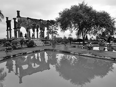 reflections of a garden ruin (SM Tham) Tags: asia indonesia bali island karangasem amlapura tamanujong waterpalace watergardens gardenstosee pavilion building ruin gardenfolly pond water reflections tree pots plants shrubs blackandwhite monochrome outdoors