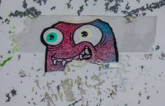 He Has Come Unstuck (Steve Taylor (Photography)) Tags: teeth face monster alien eye sellotape smile blue pink glitter art graffiti sticker streetart green black red yellow white fun happy smiling newzealand nz southisland canterbury christchurch cbd city