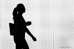 A Silhouetted Shopper (CVerwaal) Tags: blackandwhite silhouettes timewarnercenter newyork ny usa michaelkors