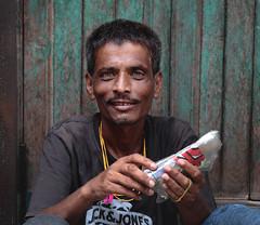 the hazel eyed man (Richik_Phoenix) Tags: people eye portrait poor india outdoor color face green hand art man struggle hazel