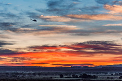 Flyby Sunrise (inlightful) Tags: sunrise sunset morning evening sky clouds colorful helicopter fly flying flyby orange rural southwest quebradas newmexico socorrocounty