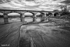 Tyrnavos (kzappaster) Tags: bridge bw reflection samsung greece pancake 16mm larissa ifn stonebridge thessaly mirrorless nx100 tyrnavos samsungnx samsungnx100 compactsystemcamera 16mmf24